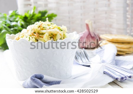 Coleslaw - cabbage salad with carrot, parsley and mayonnaise