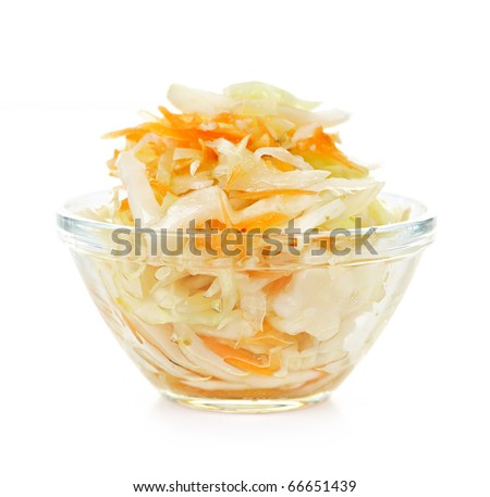 Coleslaw in glass bowl on white background - stock photo