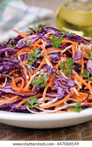 Coleslaw salad of red cabbage with carrots, Celery root - stock photo