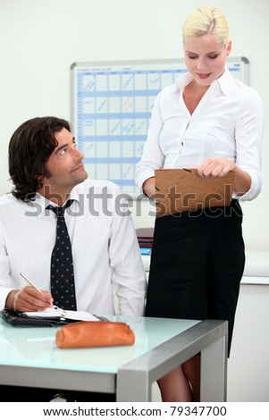 Collaboration between colleagues - stock photo