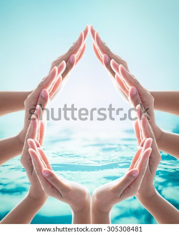 Collaborative female human hands in droplet shape on blurred wavy clean water background: Saving water clean natural environment ocean concept/ campaign: Love earth, save water conceptual idea/ sign - stock photo