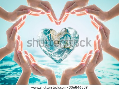 Collaborative human hand group heart shape around love green globe on blurred cyan turquoise blue wavy spa water background: Saving water CSR concept idea: Element of the image furnished by NASA       - stock photo