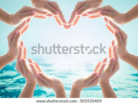 Collaborative human hands grouped in heart shape around blank copy space on blurred cyan turquoise blue wavy water background: Saving water supply clean ocean sea harmony conservation teamwork concept - stock photo