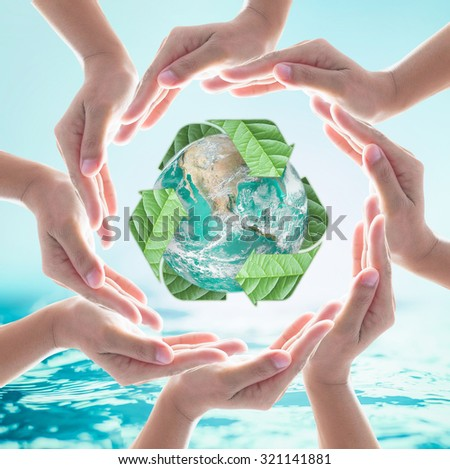 Collaborative human hands surrounding green planet protected by recycle sign leaf on turquoise cyan blue water background: Recycle, reduce, reuse idea concept: Elements of this image furnished by NASA