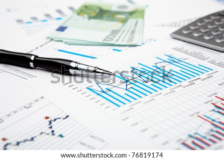 collage from financial elements with parts of skyscrapper - stock photo