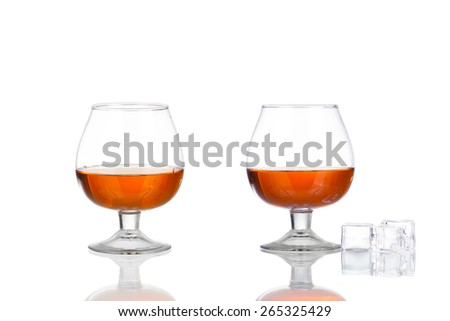 collage glass of cognac isolated on white background - stock photo