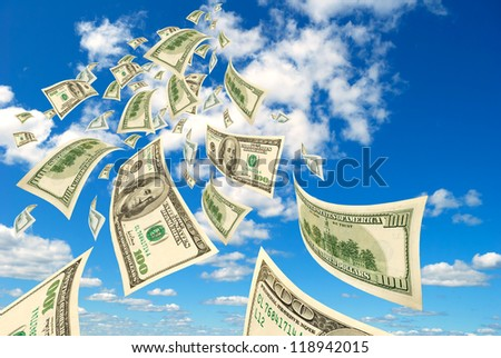 Collage - hundred-dollar bills floating in the sky. - stock photo