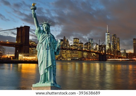 Collage - Manhattan skyline with Brooklyn Bridge at night and Statue of Liberty. - stock photo