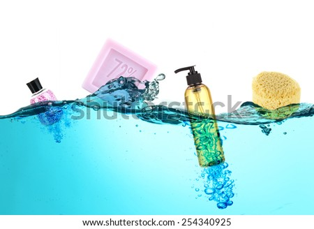 Collage of bath accessories in water - stock photo