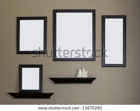 Collage of Black blank Picture Frames and shelves against brown textured wall - stock photo