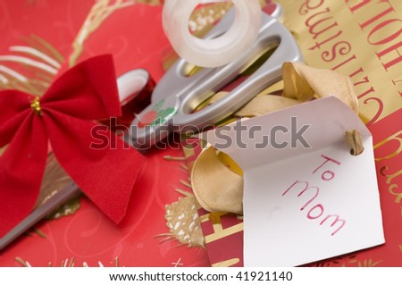 Collage of Christmas gift wrapping supplies including tape, ribbon, wrapping paper, scissors, tag, bag