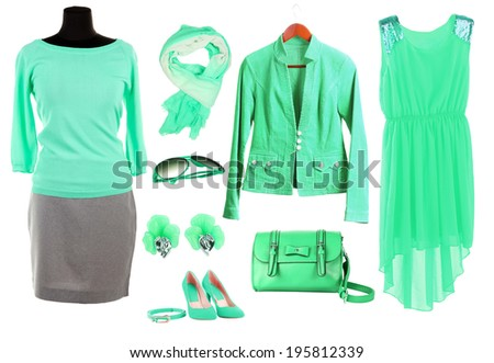 Collage of clothes in green colors isolated on white - stock photo