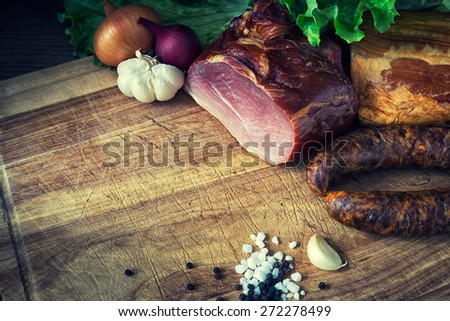 collage of different kinds of meat, smoked sausage and meat - stock photo
