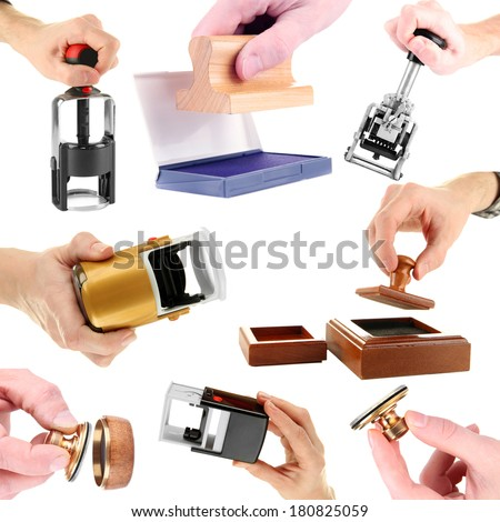 Collage of different stamps in hand isolated on white - stock photo