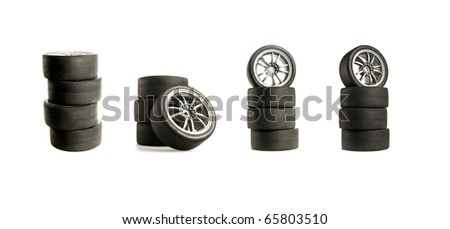Collage of Four used race tires on white background - stock photo
