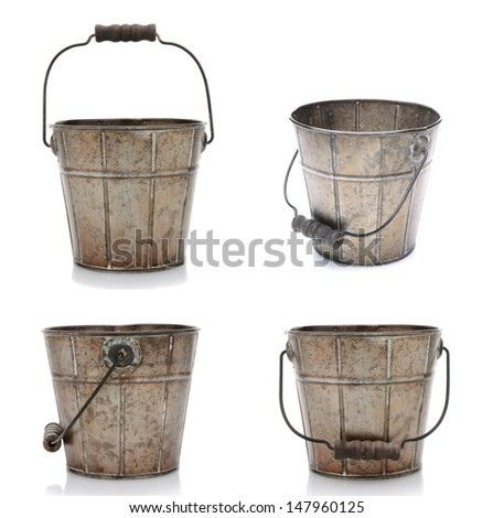 Collage of four views of an old fashioned metal bucket. Isolated on white with reflection. - stock photo
