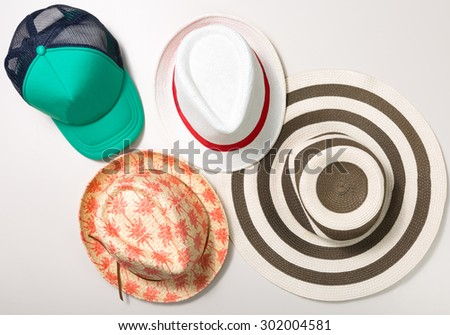 Collage of hats and cap isolated on white - stock photo