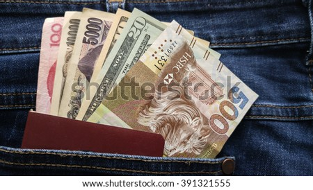 Collage of many different banknotes with passport in jeans   Concept  World Travel
