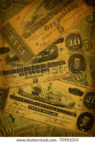 Collage of old, dirty and very worn five, ten and dollar bills printed by the Confederate states of America in 1864 during the Civil War. - stock photo