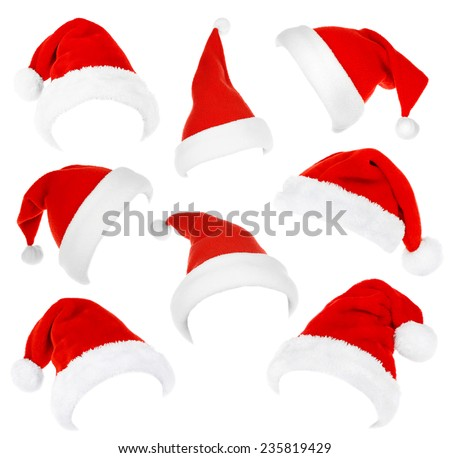 Collage of Santa hats isolated on white - stock photo