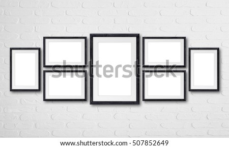 collage of seven black natural wooden frames on bricks wall