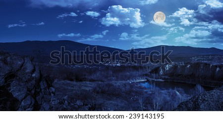 collage of small lake in an abandoned stone quarry in the mountains outside the city at night in full moon light - stock photo