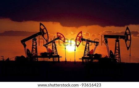 Collage. Oil field at sunset. - stock photo