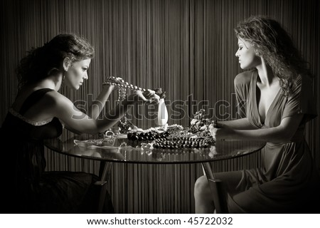 Collage. Two beauty passionate girl with  accessories - stock photo