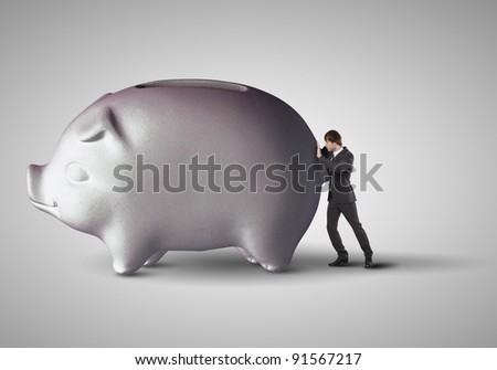 Collage with a piggybank and young business man - stock photo