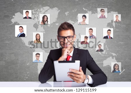Collage with a smiling business man with tablet pad  against technology background, communicating with entire world - stock photo