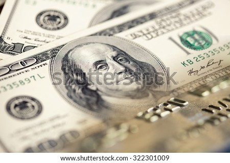 Collage with one hundred US dollar bills and credit card - stock photo