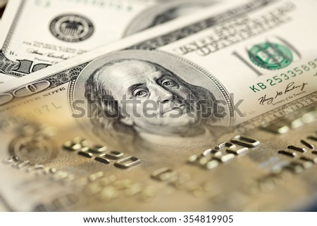 Collage with one hundred US dollar bills and credit cards - stock photo
