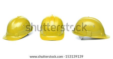 Collagr of yellow hard hats - stock photo