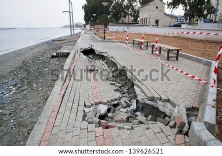 Collapsed and cracked pedestrian alley after ebb, on the coast of Mediterranean sea,Cyprus