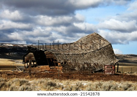 Collapsed Barn with part of an old truck - stock photo