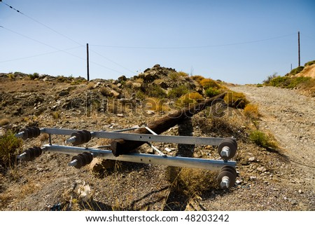 Collapsed old wooden power line pole - stock photo