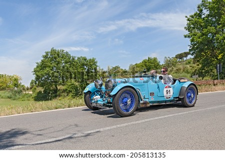 COLLE DI VAL D'ELSA, SI, ITALY - MAY 17: the crew Jan and Karel Ten Cate on a racing car Aston Martin  Le Mans (1933) in race Mille Miglia, on May 17, 2014 in Colle di Val d'Elsa, Tuscany, Italy