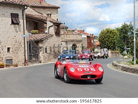 COLLE DI VAL D'ELSA, SI, ITALY - MAY 17: unidentified crew on a vintage car Maserati 200 SI (1957) runs in historical rally Mille Miglia, on May 17, 2014 in Colle di Val d'Elsa, Tuscany, Italy  - stock photo