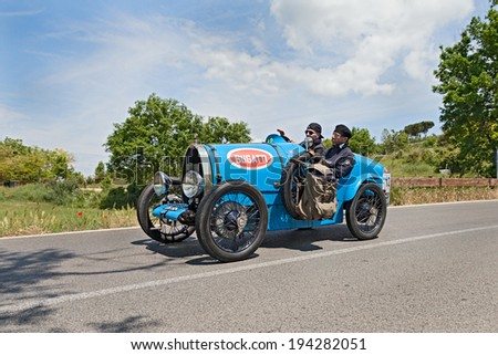 COLLE DI VAL D'ELSA, SI, ITALY - MAY 17: unidentified crew on an old sport car Bugatti T 13 Brescia Corsa (1928) runs in historical race Mille Miglia, on May 17, 2014 in Colle di Val d'Elsa, SI, Italy - stock photo