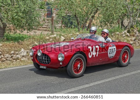 COLLE VAL D'ELSA, SI, ITALY - MAY 17: drivers J. Newman P. Hardy on a vintage sports car Ermini 1100 Sport Motto (1952) in classic car race Mille Miglia on May 17, 2014 in Colle Val d'Elsa, SI, Italy  - stock photo