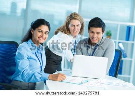 Colleagues cooperating to achieve better results - stock photo