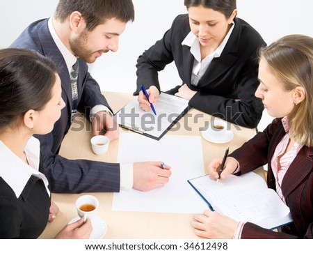 Colleagues discuss results of the done work - stock photo