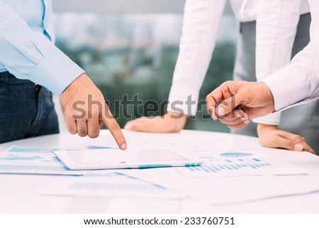 Colleagues discussing business strategy - stock photo