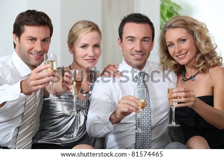 Colleagues drinking a glass of champagne