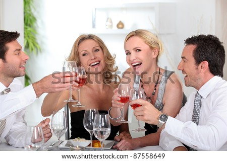 Colleagues drinking a glass of wine - stock photo