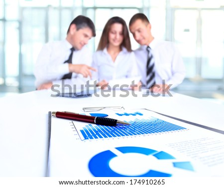 Colleagues meeting to discuss their future financial plans - stock photo