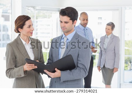Colleagues speaking about work in the office - stock photo