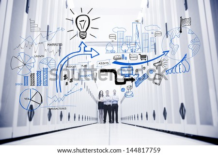 Colleagues standing in a data center in front of drawings of charts - stock photo