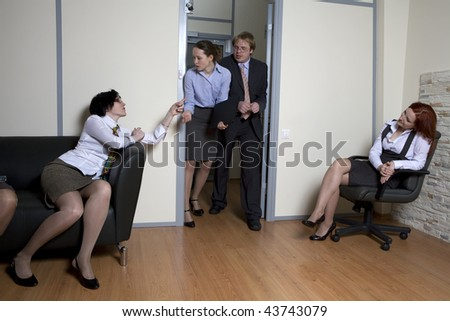 Colleagues struggle in doors for chance be first in boss`s office. Office people