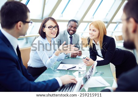 Colleagues talking at briefing - stock photo